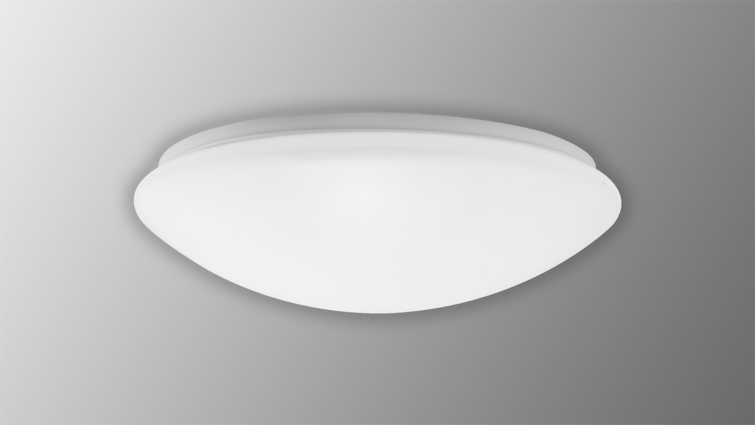 Round luminaire with light sensor