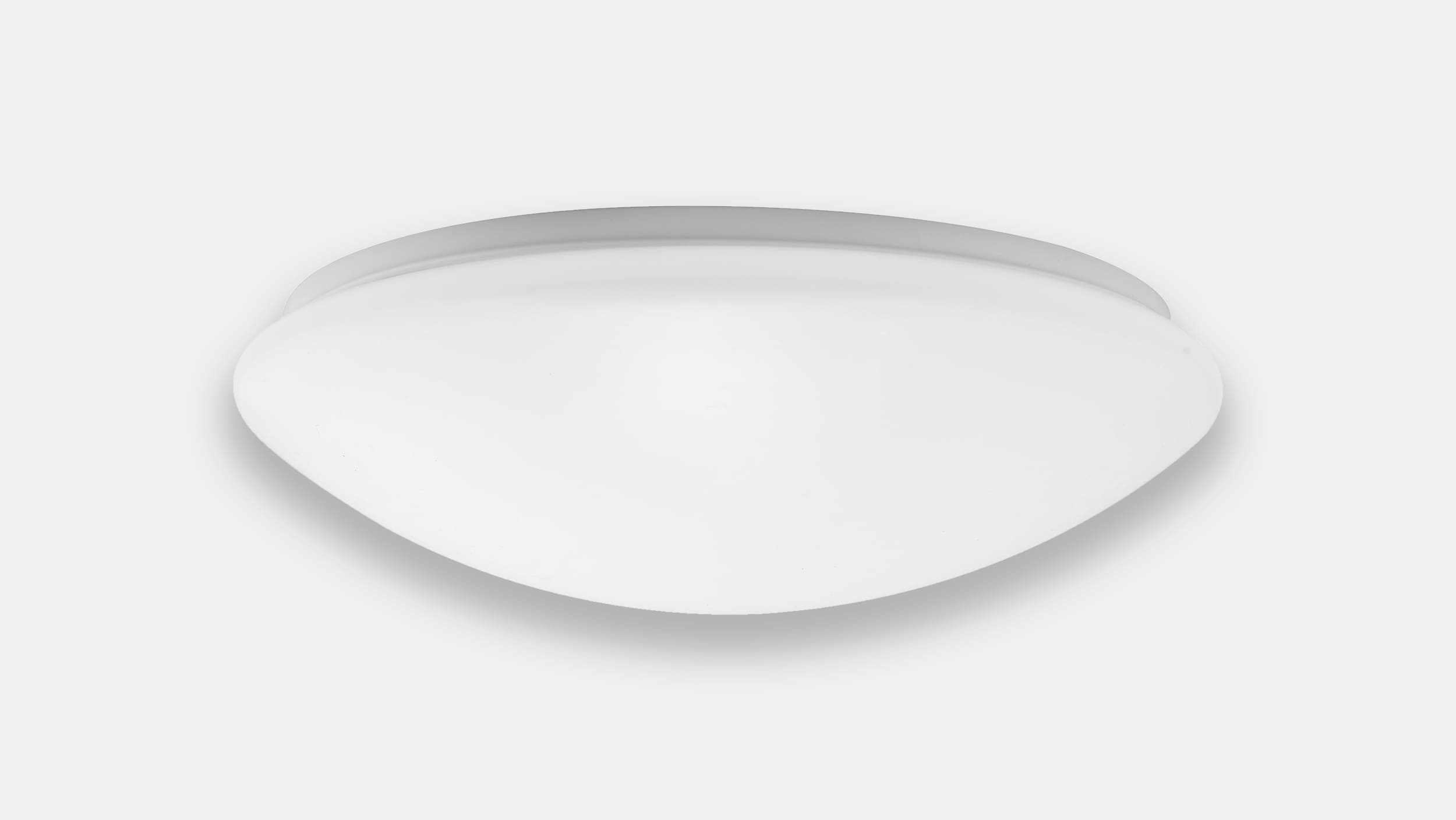 Round luminaire with motion sensor